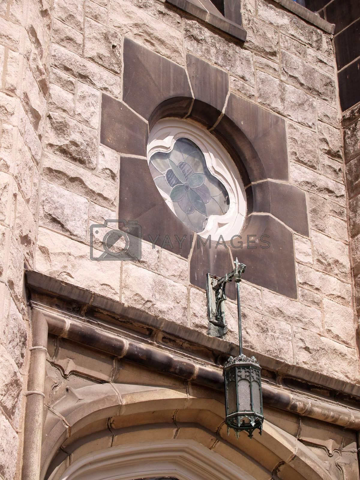 window on an old stone church