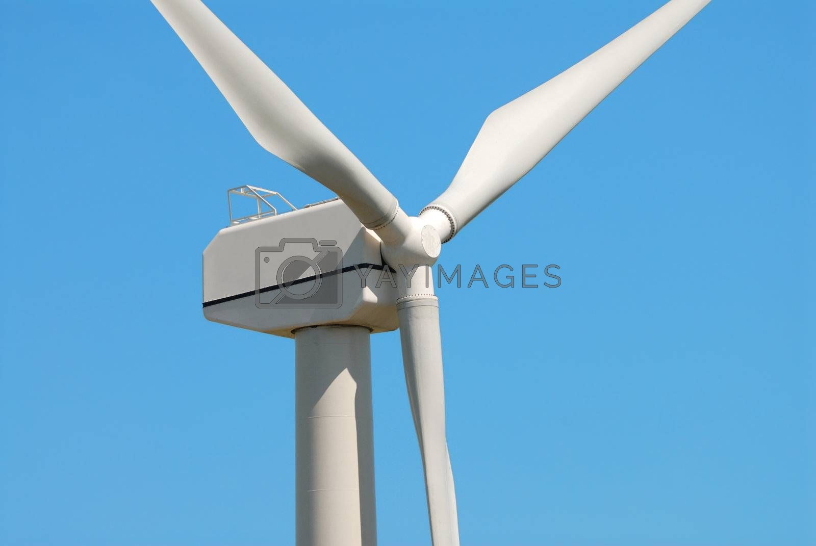 Photo of windmill against blue sky
