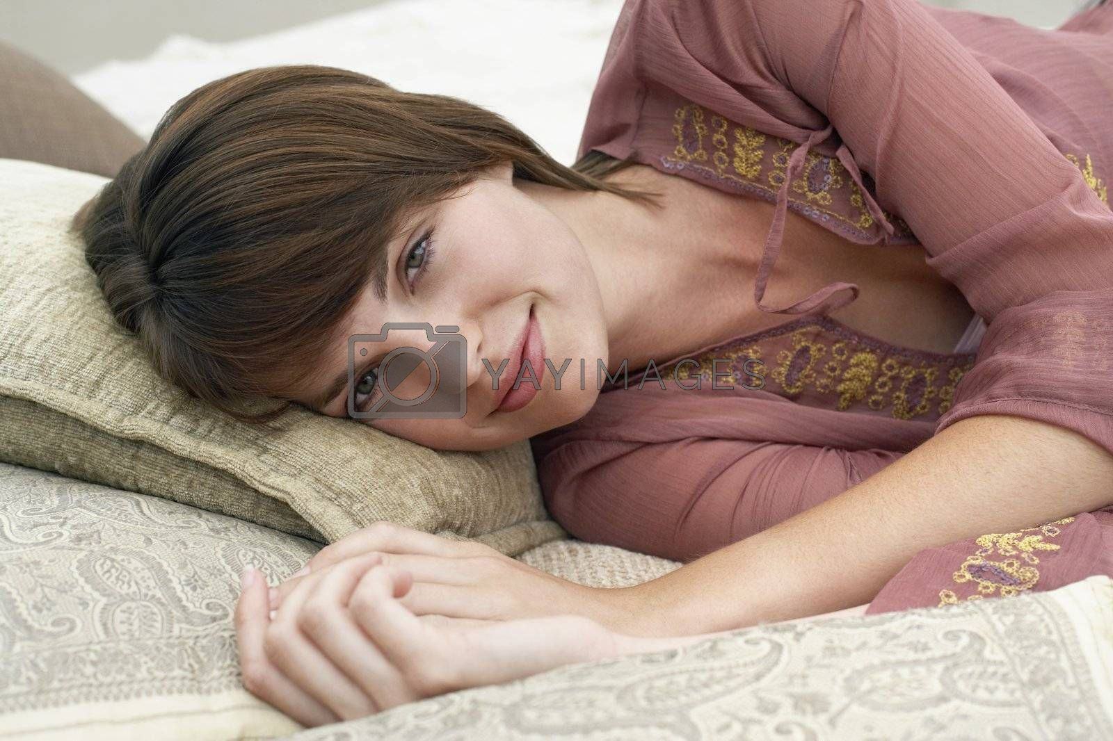Woman Laying on Pillows