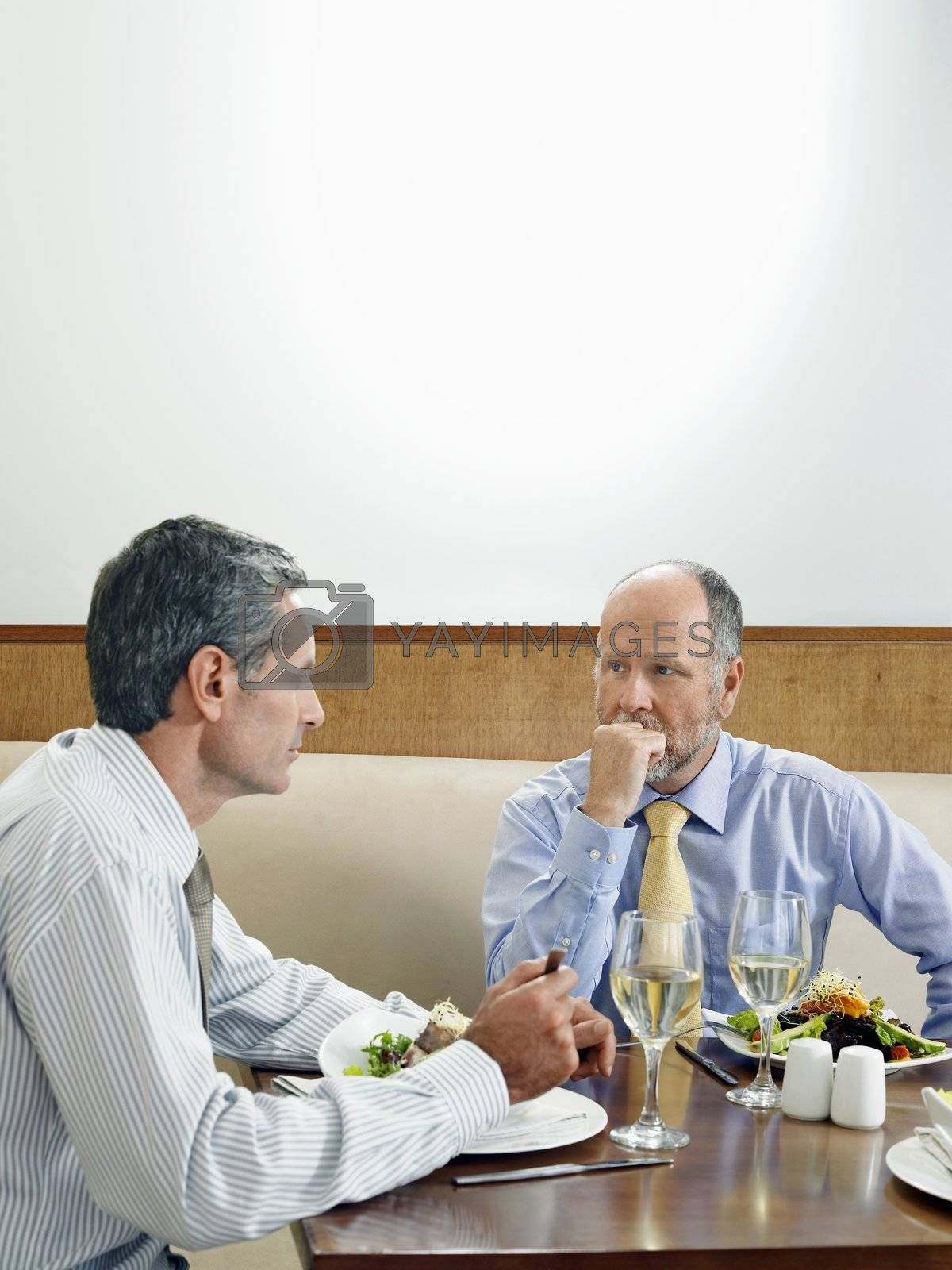 Businessmen Eating at Restaurant