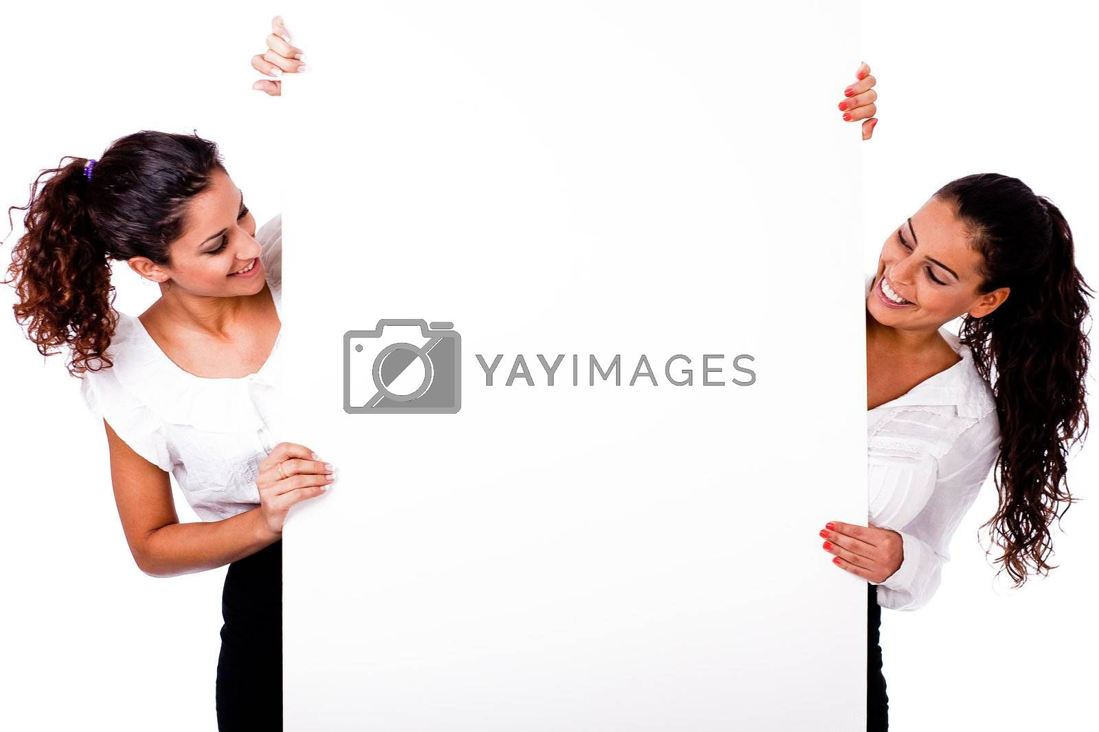 Full length santa woman smiling with white board in a isolated background