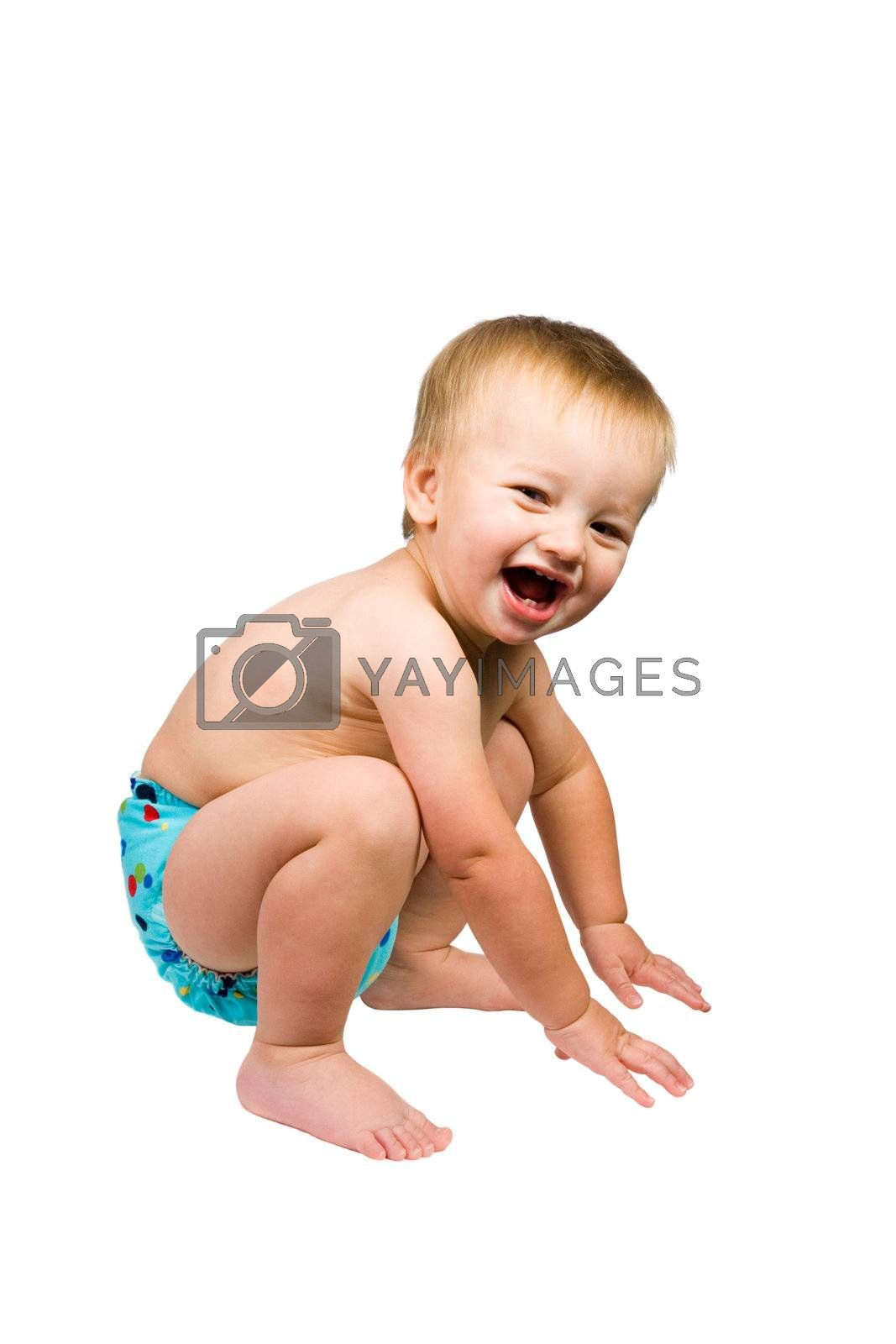 A portrait of a cute baby boy isolated wearing a cloth diaper.