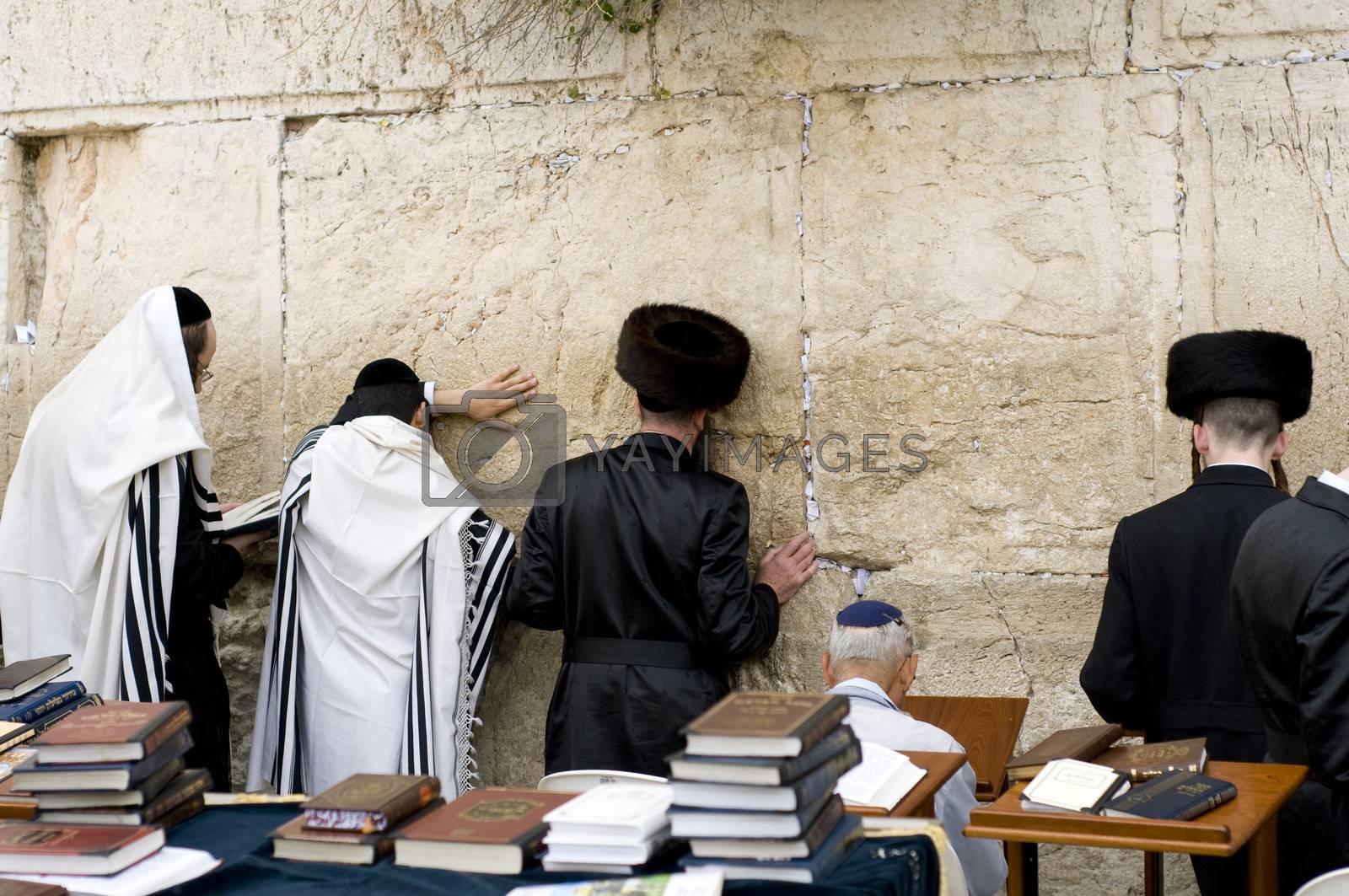 Jewish praying near Jerusalem western wall during passover celebration