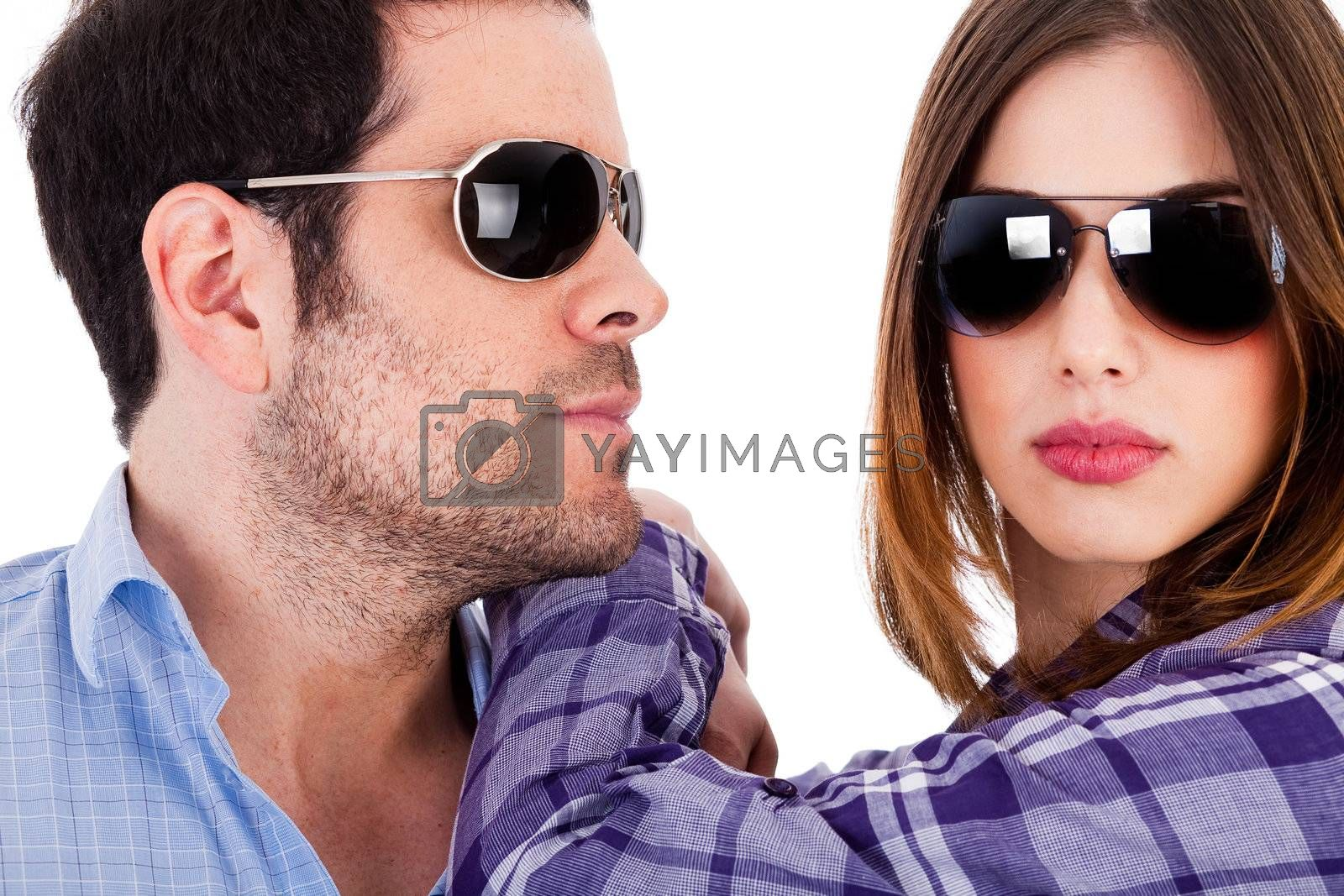 Closeup shot of fashion models wearing sunglasses on a isolated background