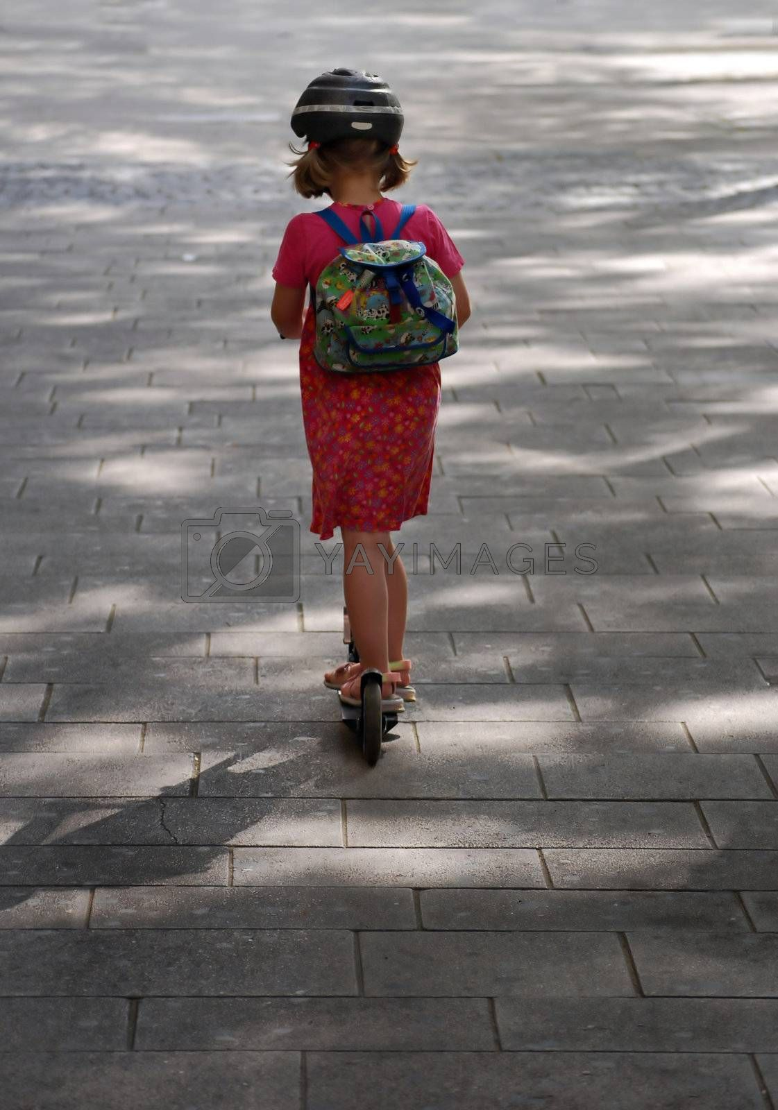 Young girl on her way to school in Vienna, Austria