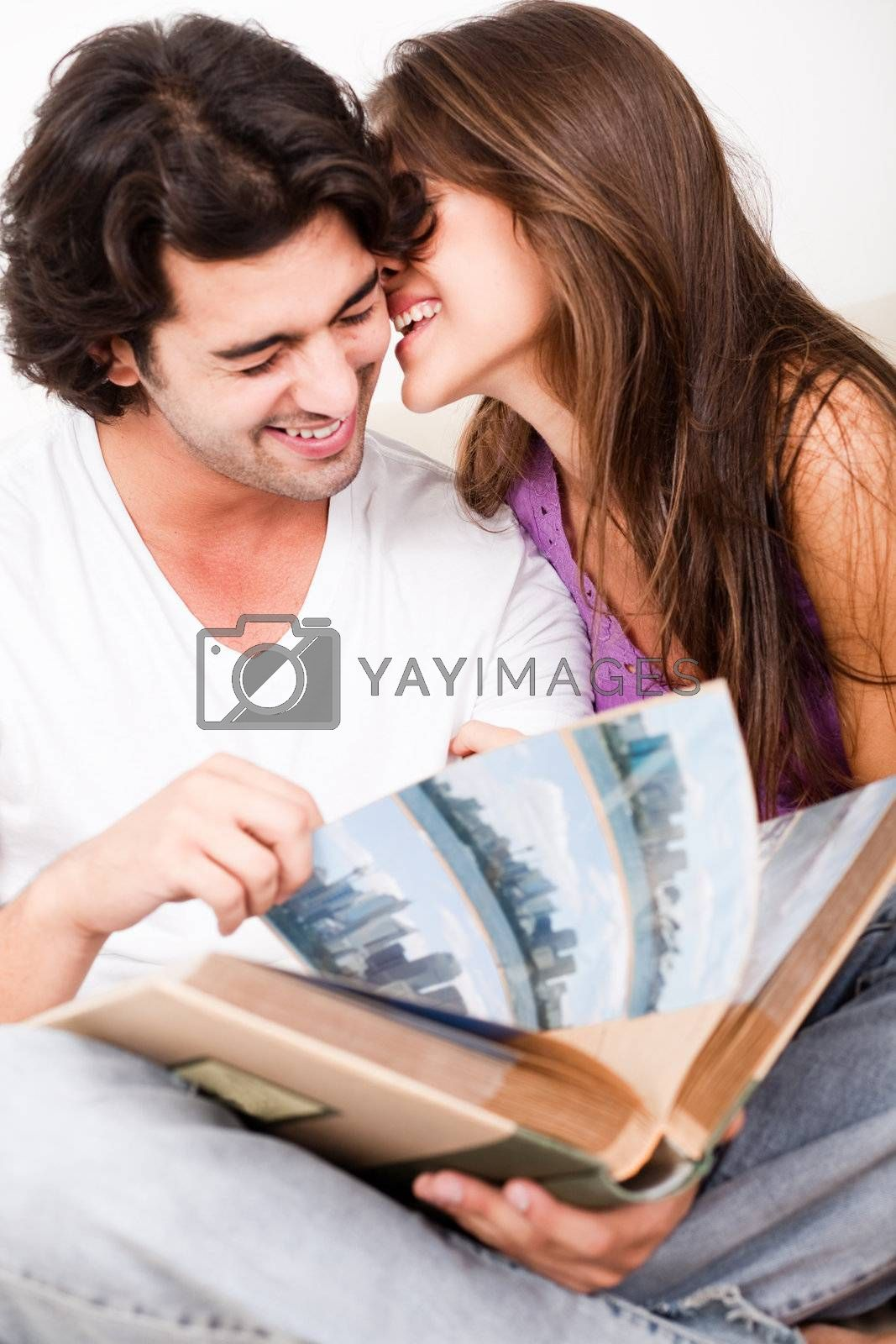 cute couple embracing in living room on isolated white background