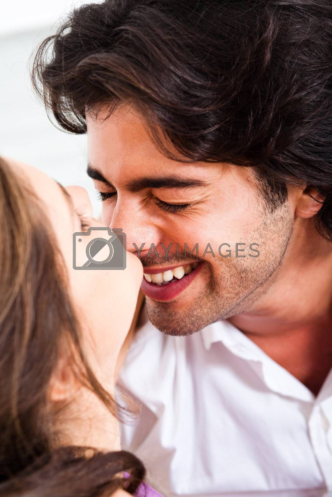 happy young couple making their love in living room