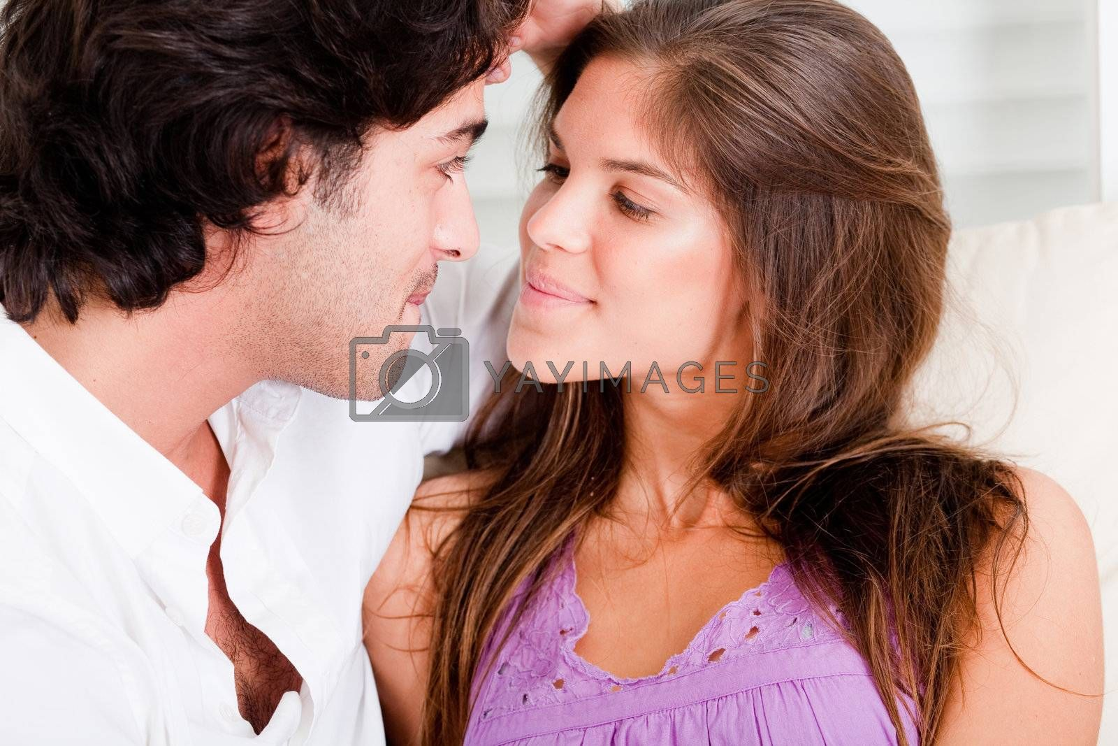 portrait of romantic young couple in passion look eachother in causel wear