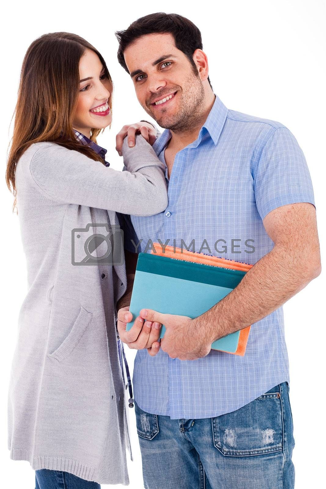 Girl looking at her boyfriend by her hands on his shoulders on a white background