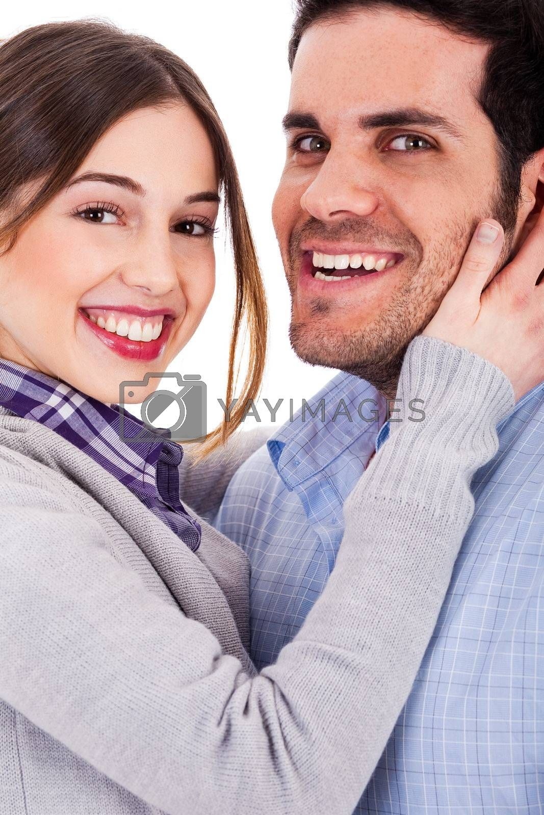 Young couple  hugging each other and smiling on a isolated white background