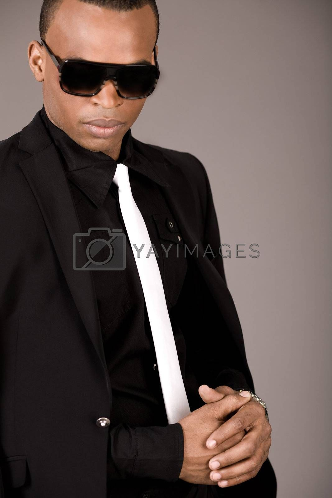 Portrait of young african business man in formal clothing on a grey background
