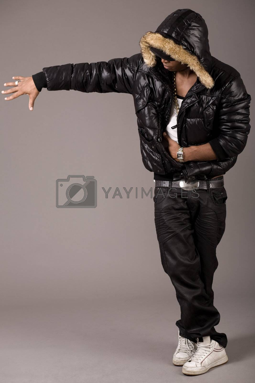 Black african rap performer on grey background