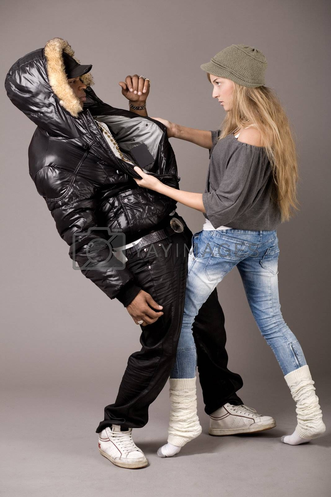 White woman fighting with her boyfriend on grey background