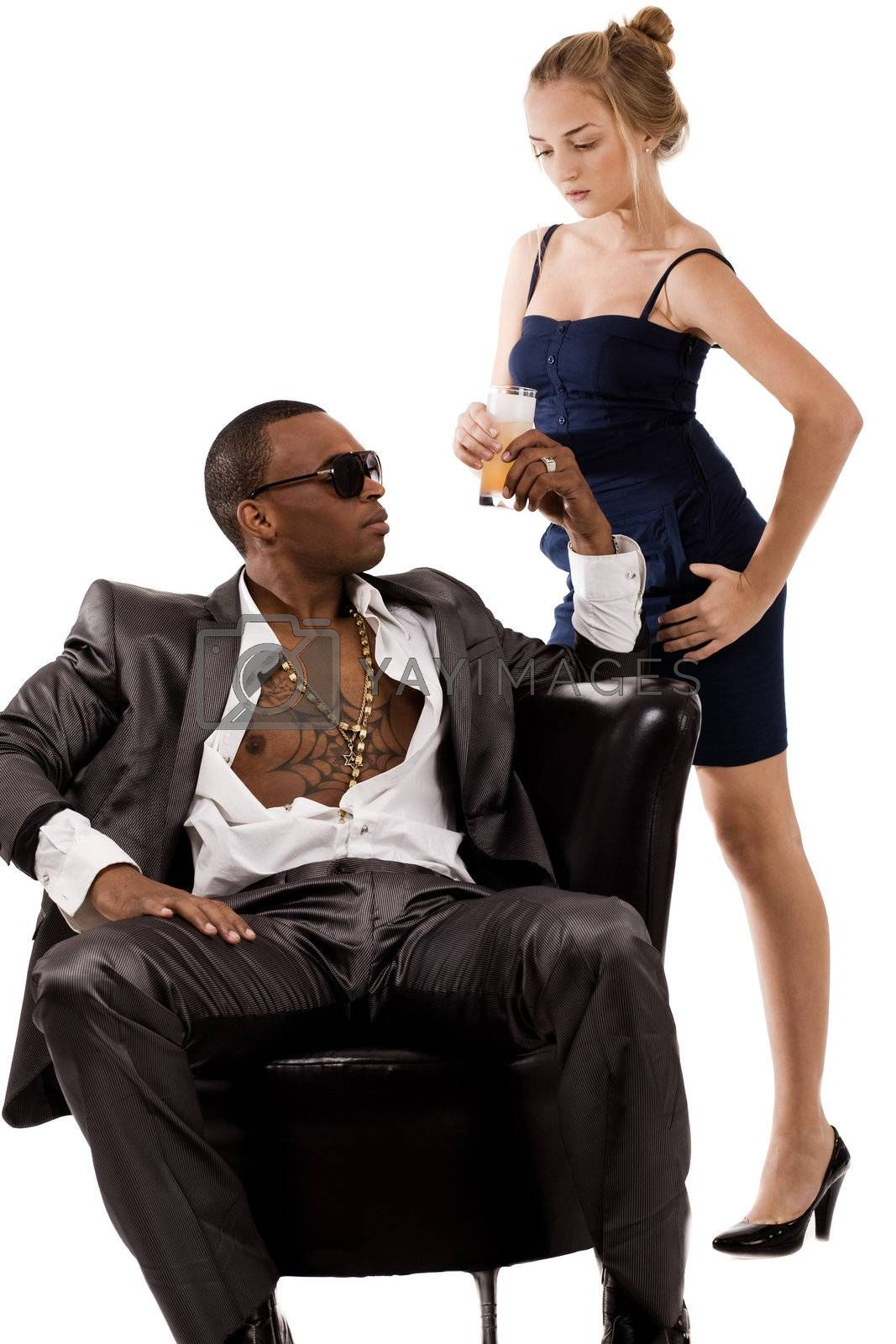 Young lady gives juice to the black man on a isolated white background