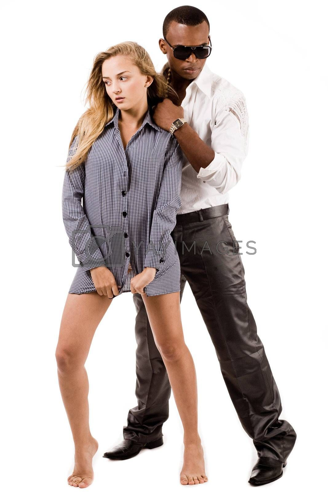 Full length image of sexy lady and stylish young black man standing indoor studio