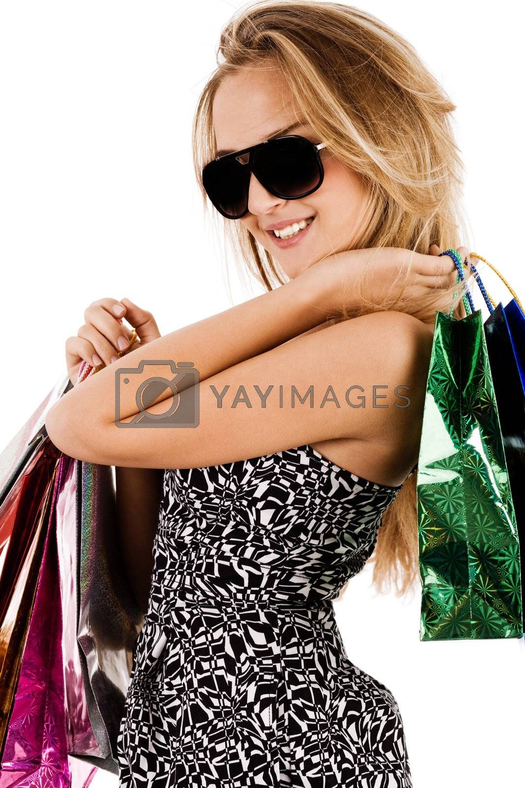 Lovely young model with shopping bags on a white background