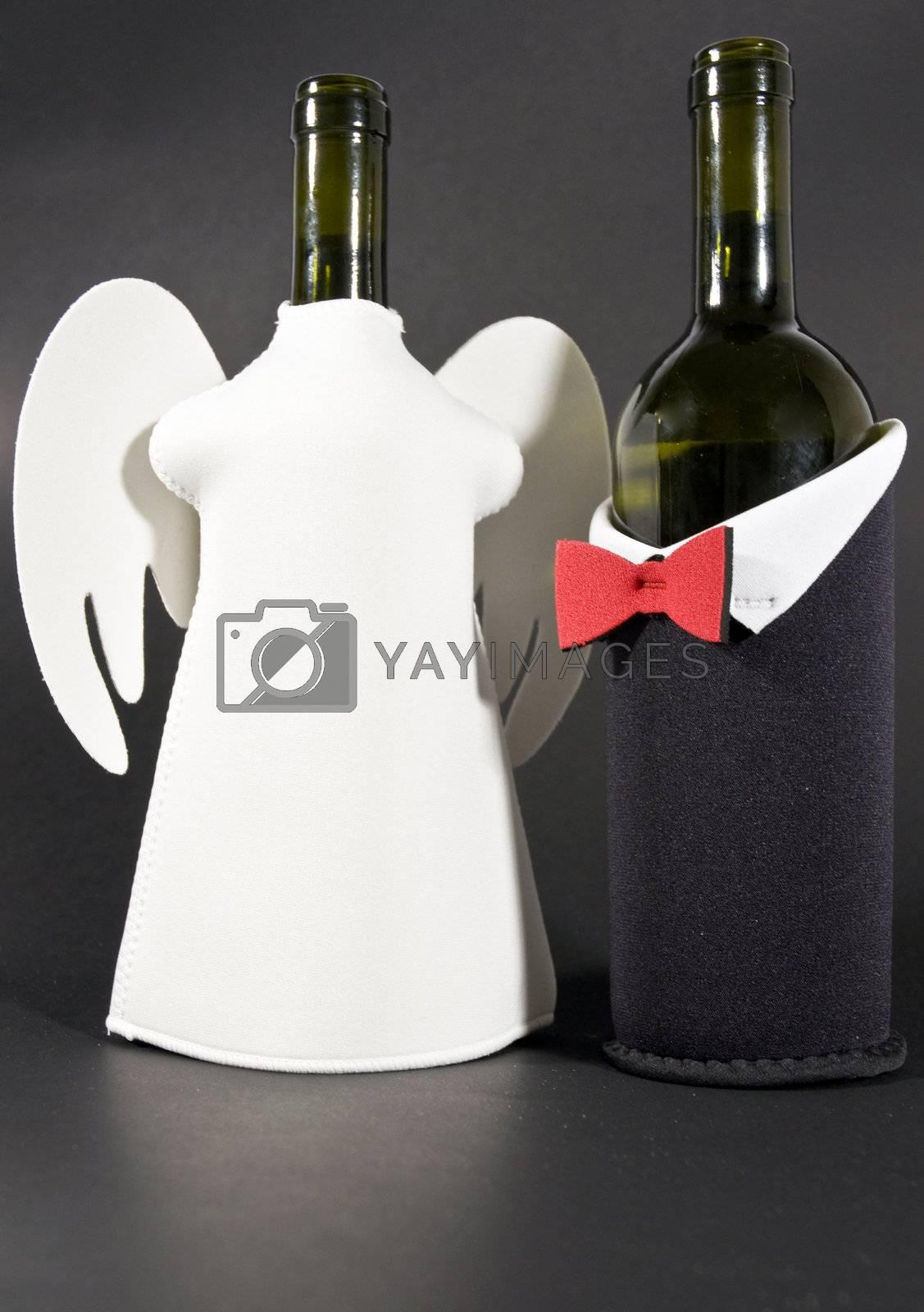 two bottles of wine, dressed on black