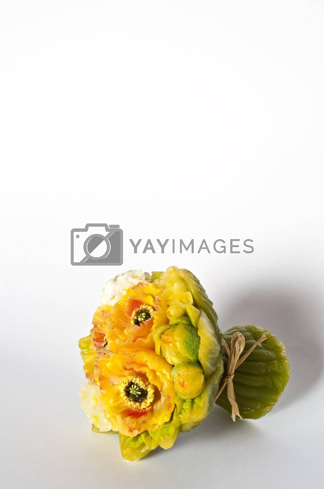 candle-shaped bouquet of flowers on a white background