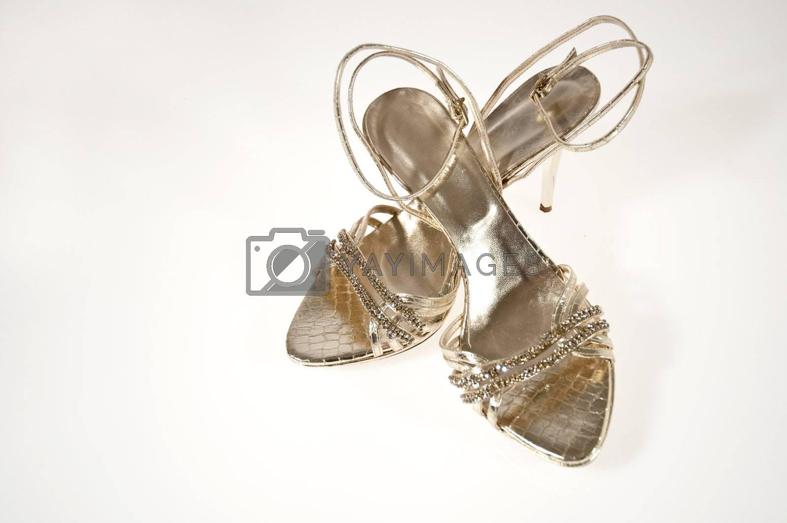 A pair of golden sandals women's Rhinestone
