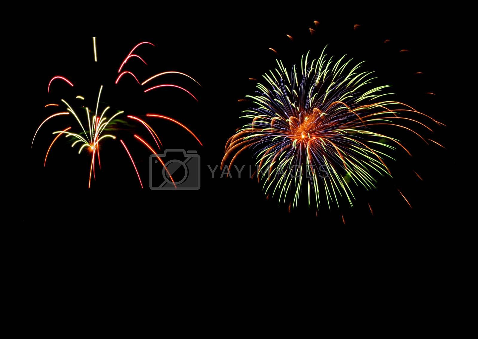 Fireworks against a black sky with copy space.