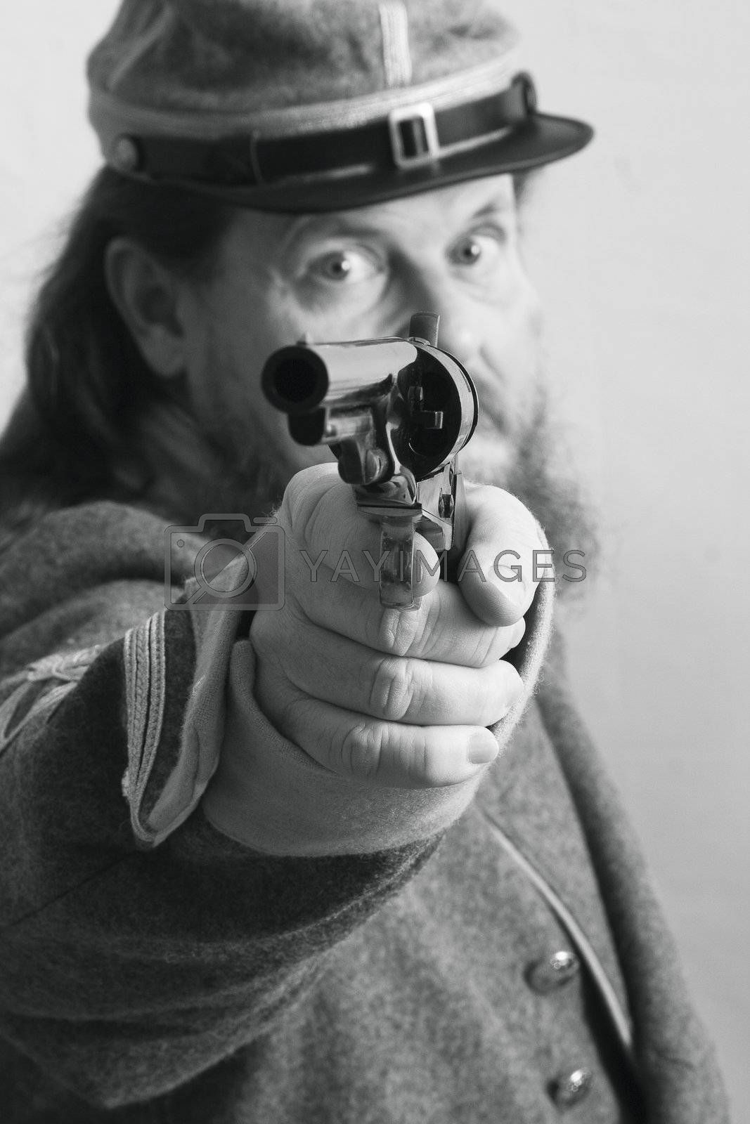Confederate officer takes aim at the enemy.