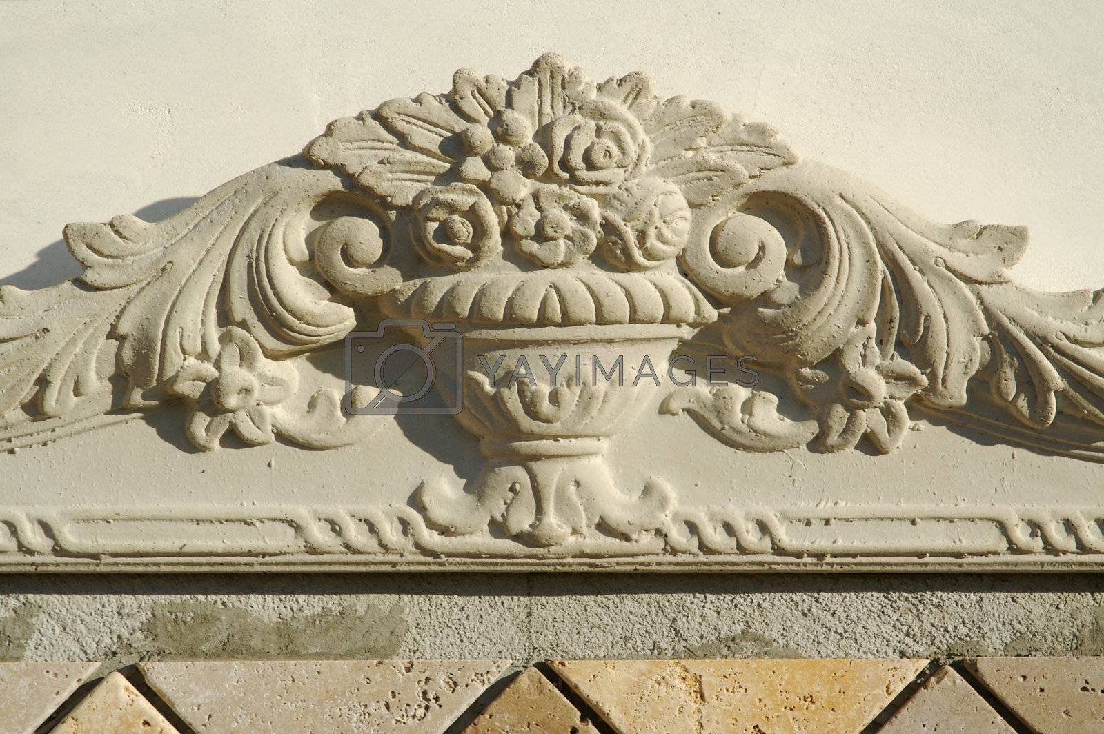Ornate Design Element on Stucco Wall