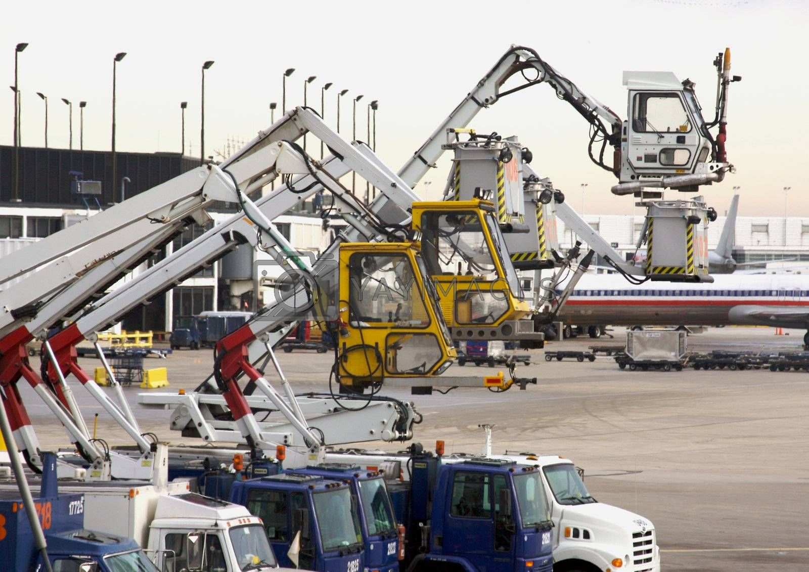 Deicing Equipment Ready at an Airport During A Blustry Winter Day