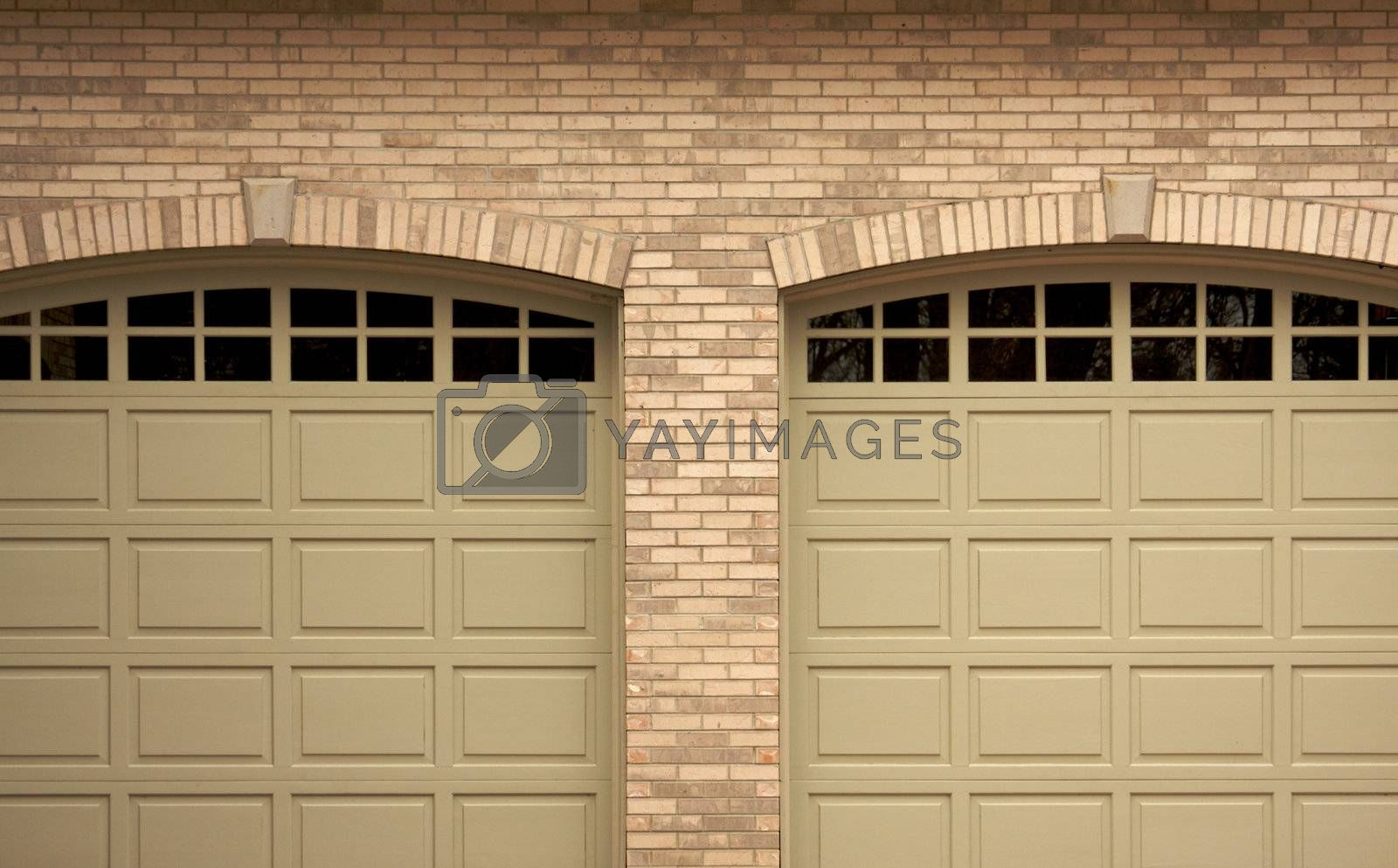 Abstract of Modern Home Brick and Garage Doors