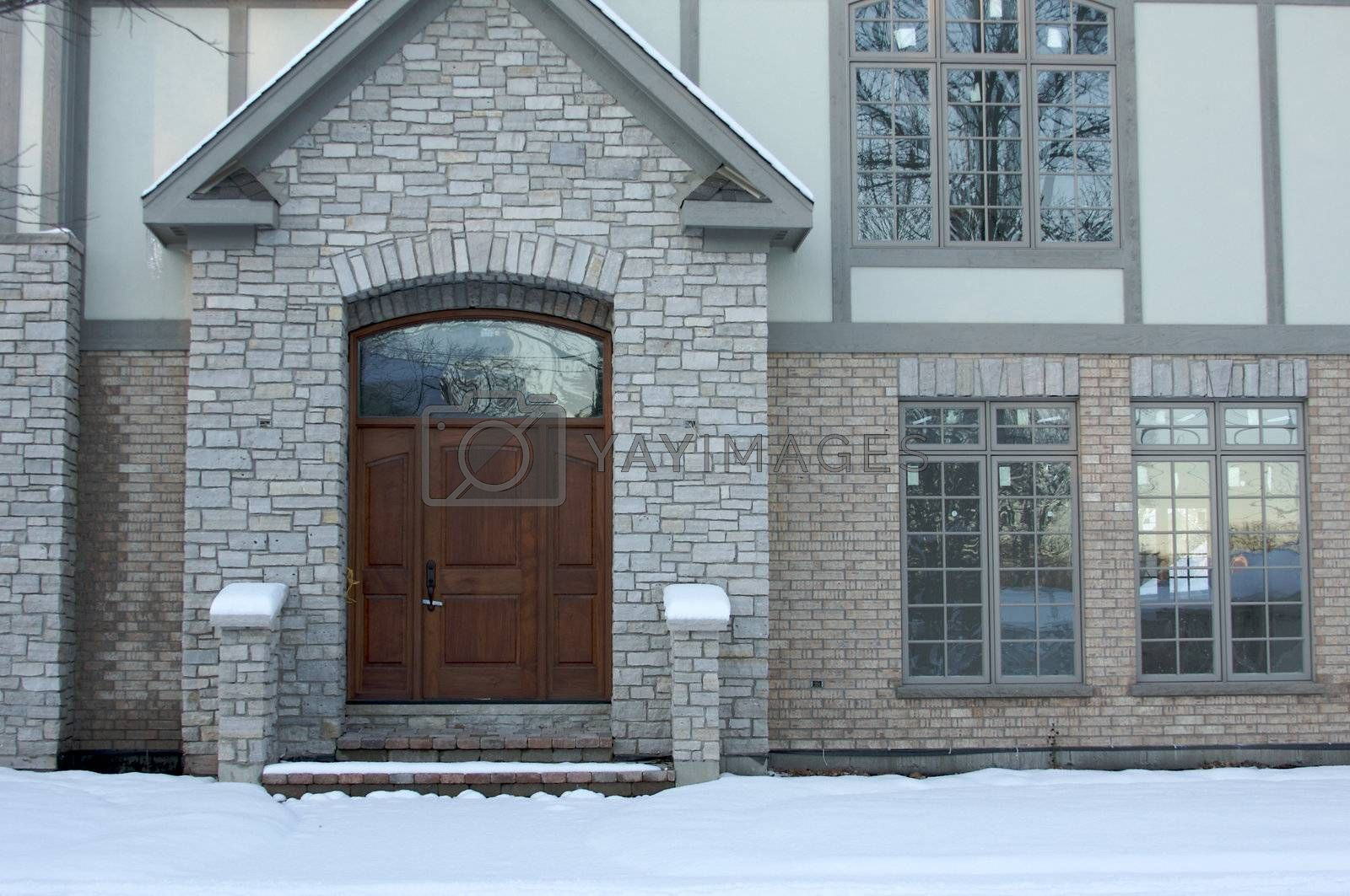 Majestic Newly Constructed Home Facade on a Blustry Winter Day