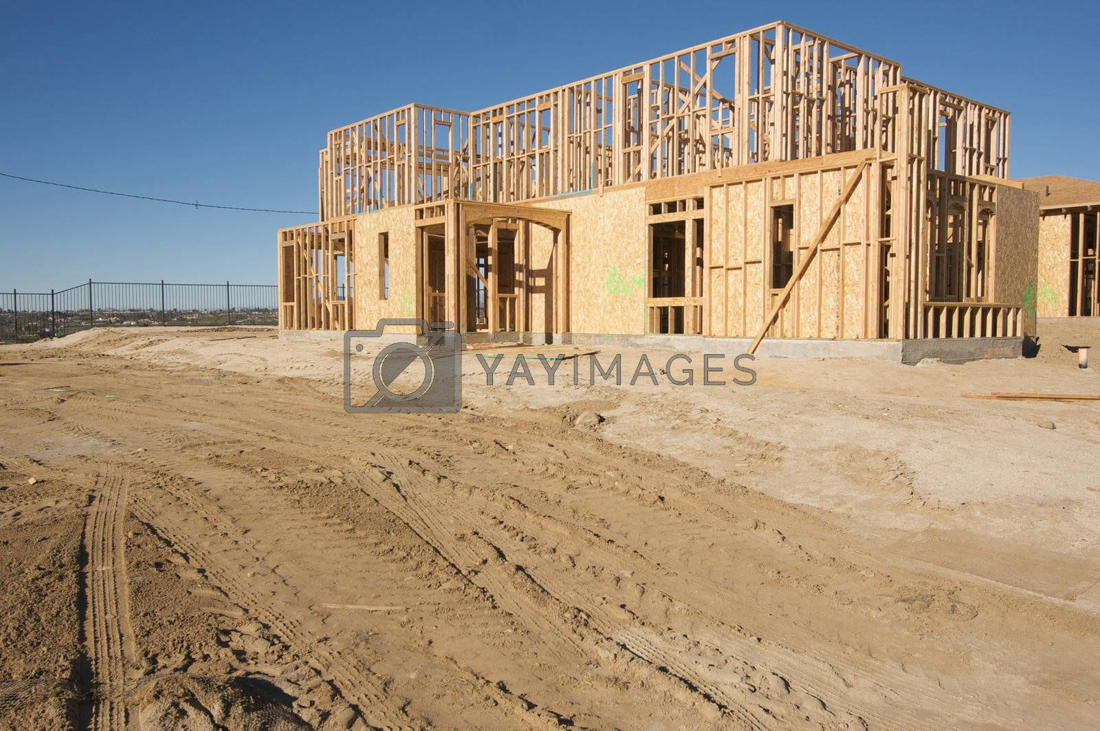 New residential construction home framing site.