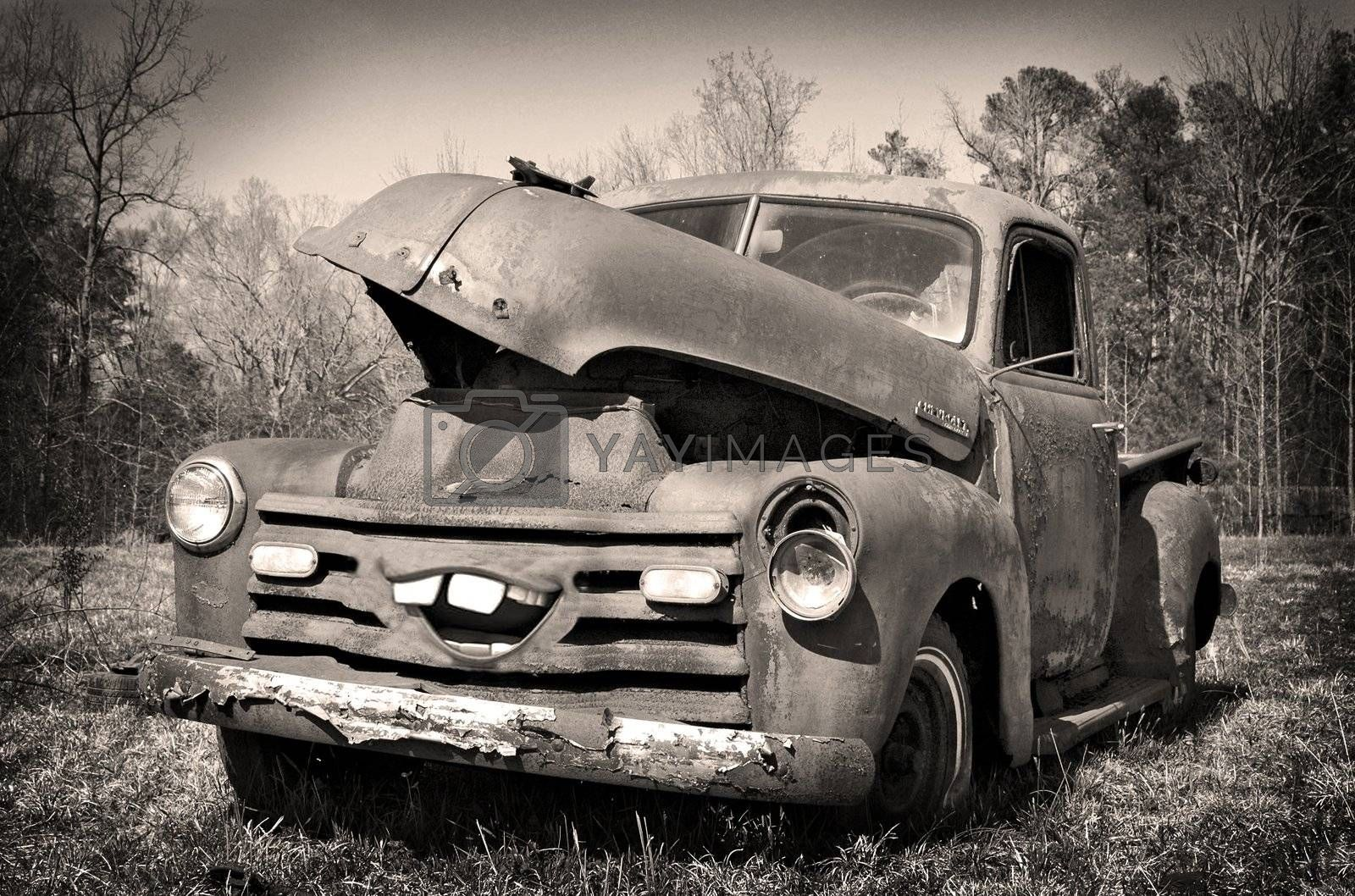 View of an old abandoned rusted out Thriftmaster Pick Up truck in Black and White with manipulation to the front grill in order to add a mouth.