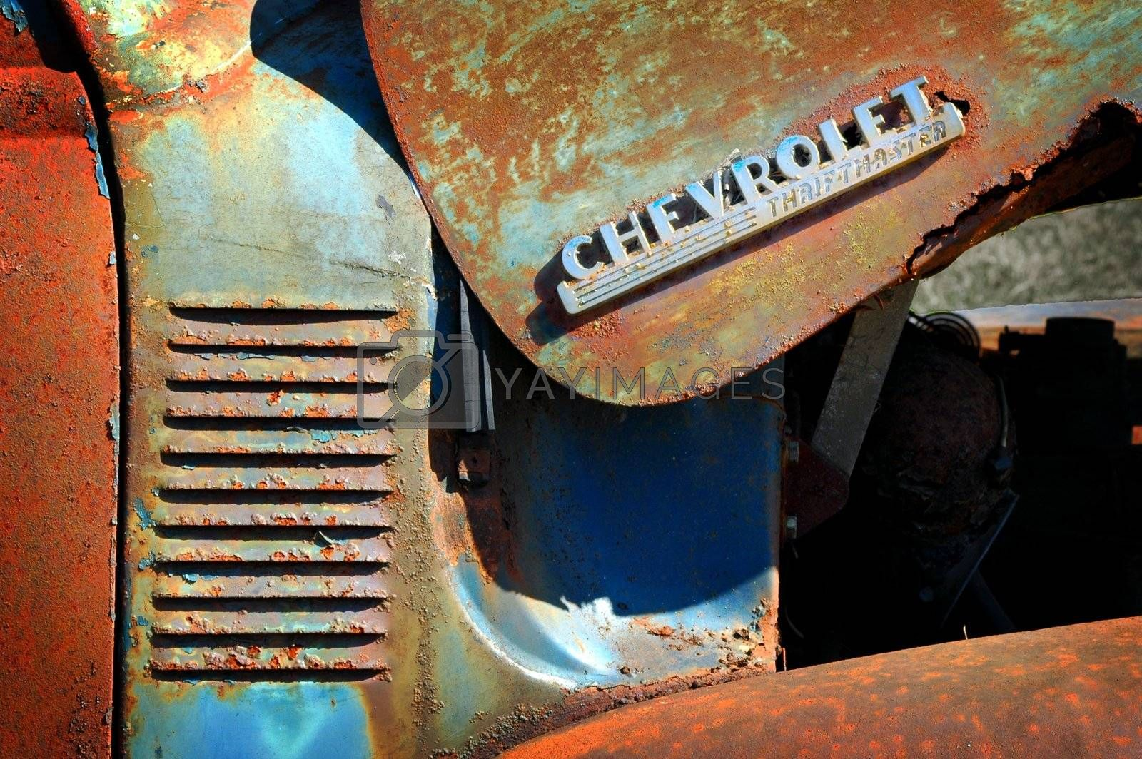 Close up view of an old abandoned rusted out Thriftmaster Pick Up truck showing the Thriftmaster logo and the side grill.