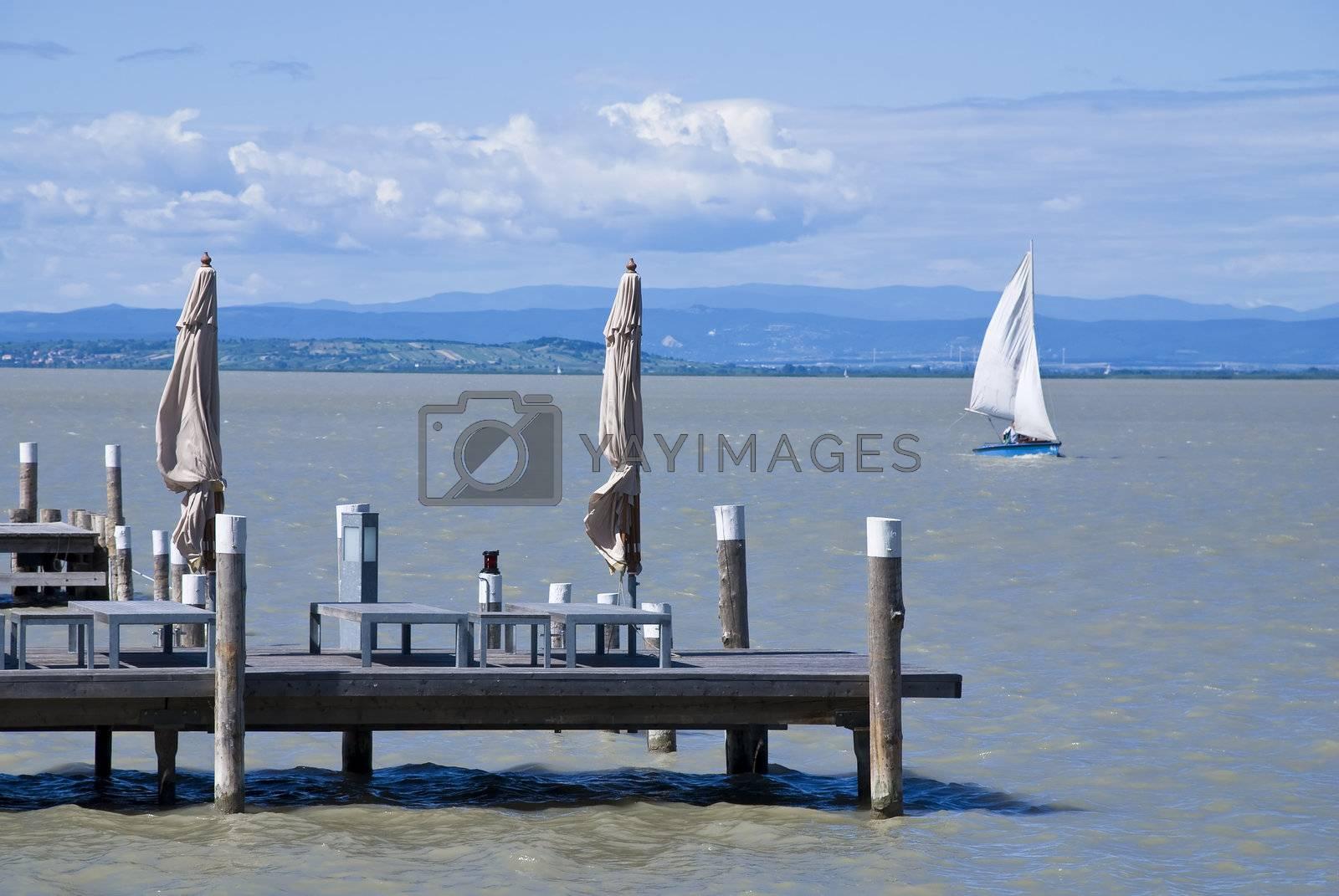 Sailing boat and pier at a lake