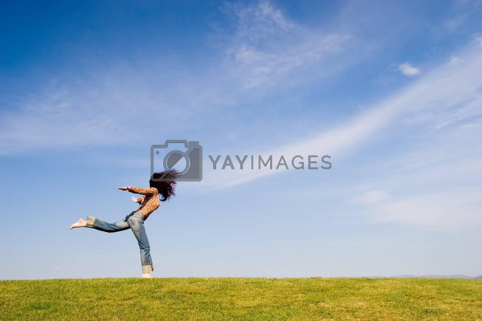 Woman on green field
