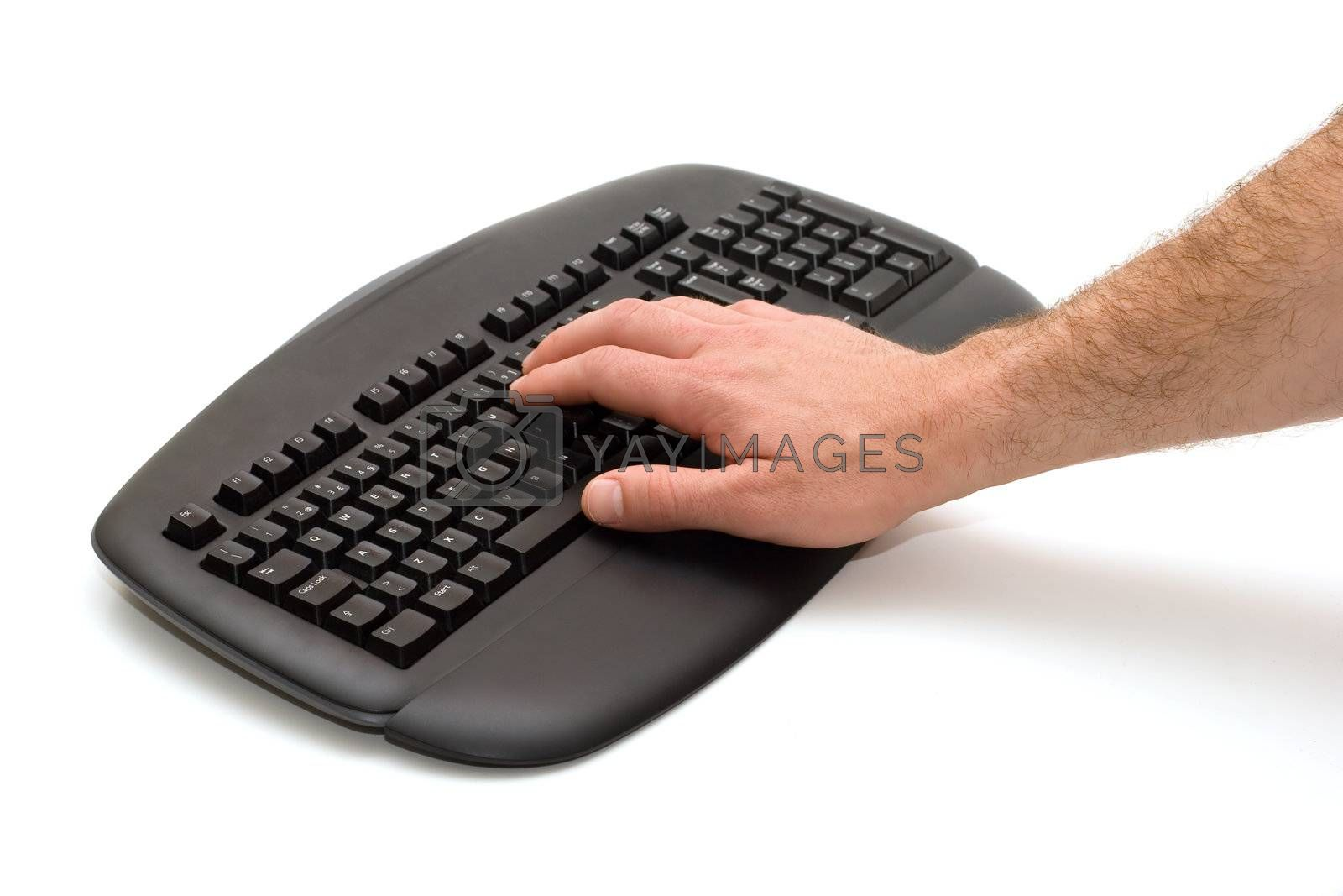 Hand typing on black keyboard on white background