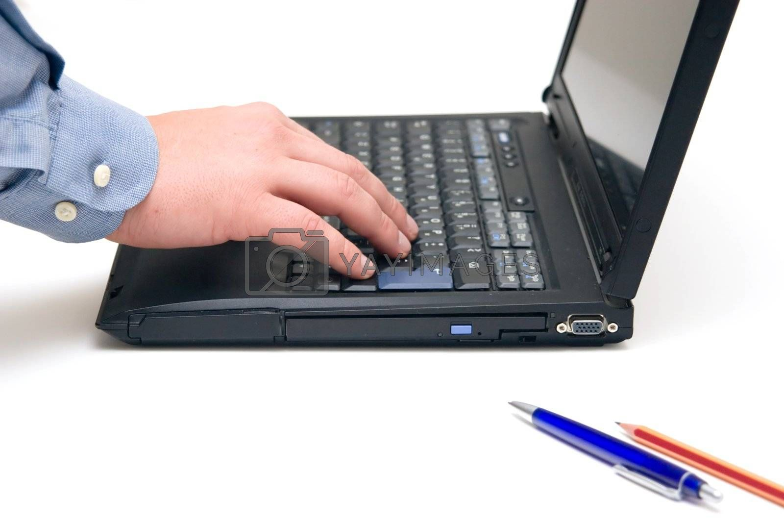 hand typing on laptop over white background.