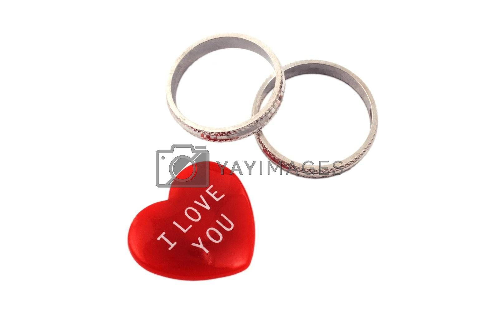 Red heart with I Love You message and two rings isolated on white