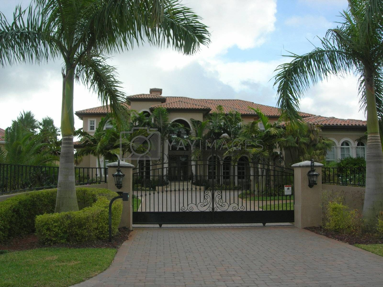 Mediterranean House with pavers, iron gate and lanscaping in miami florida