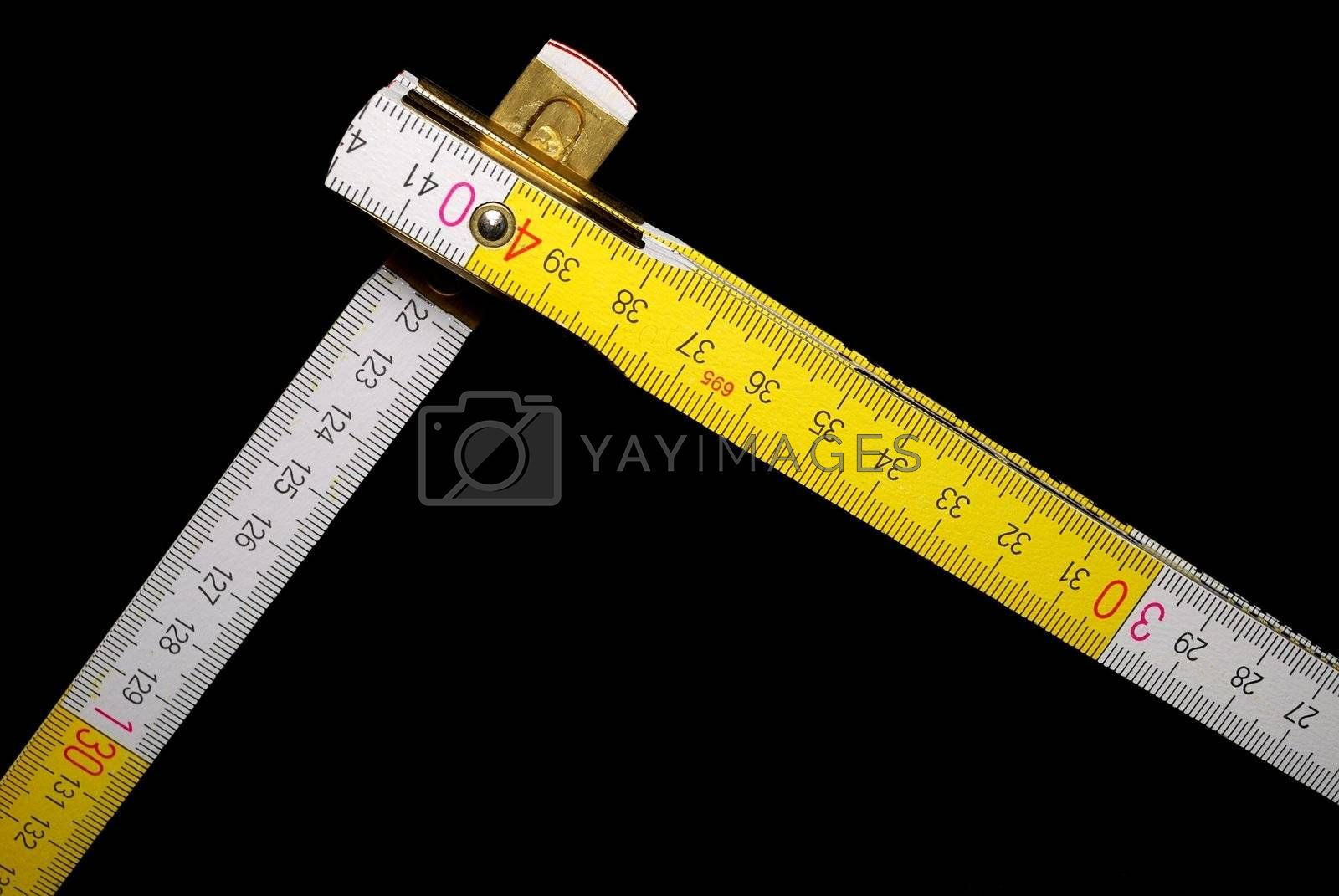 White and yellow yardstick with black background