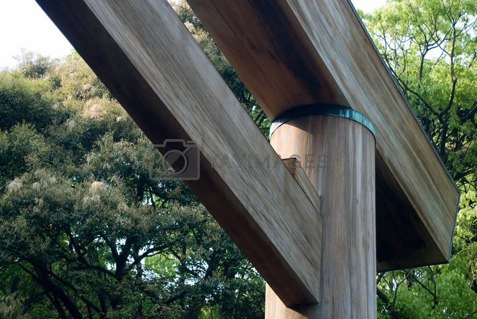 Japanese Torii Gate. Marks the entrance to a Shinto shrine. Angled corner. wood texture against greenery
