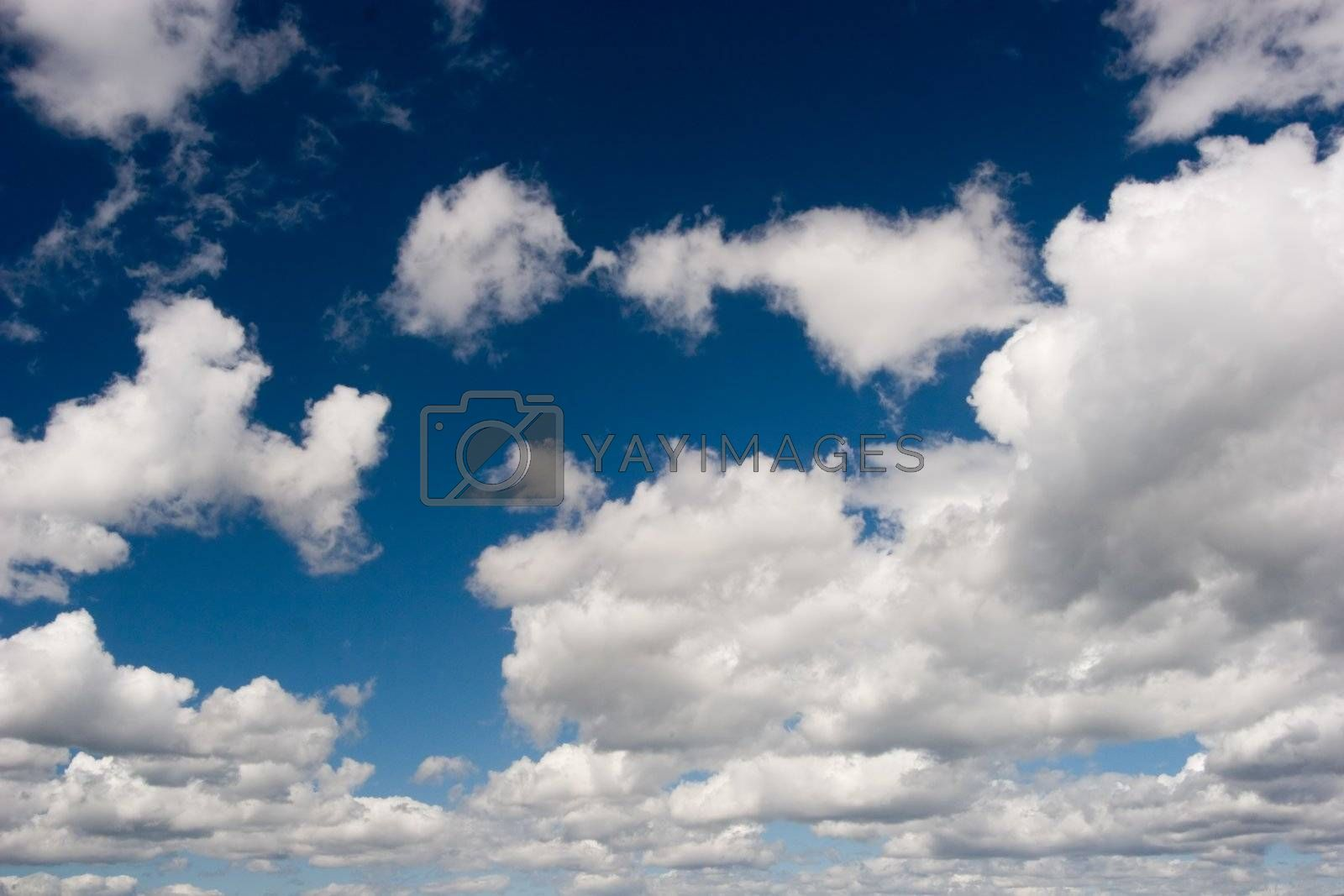 Big white clouds on blue sky.