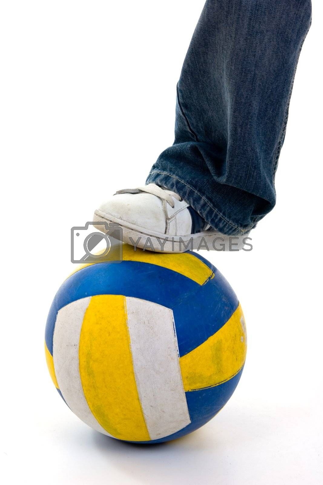 Foot on ball on white background.