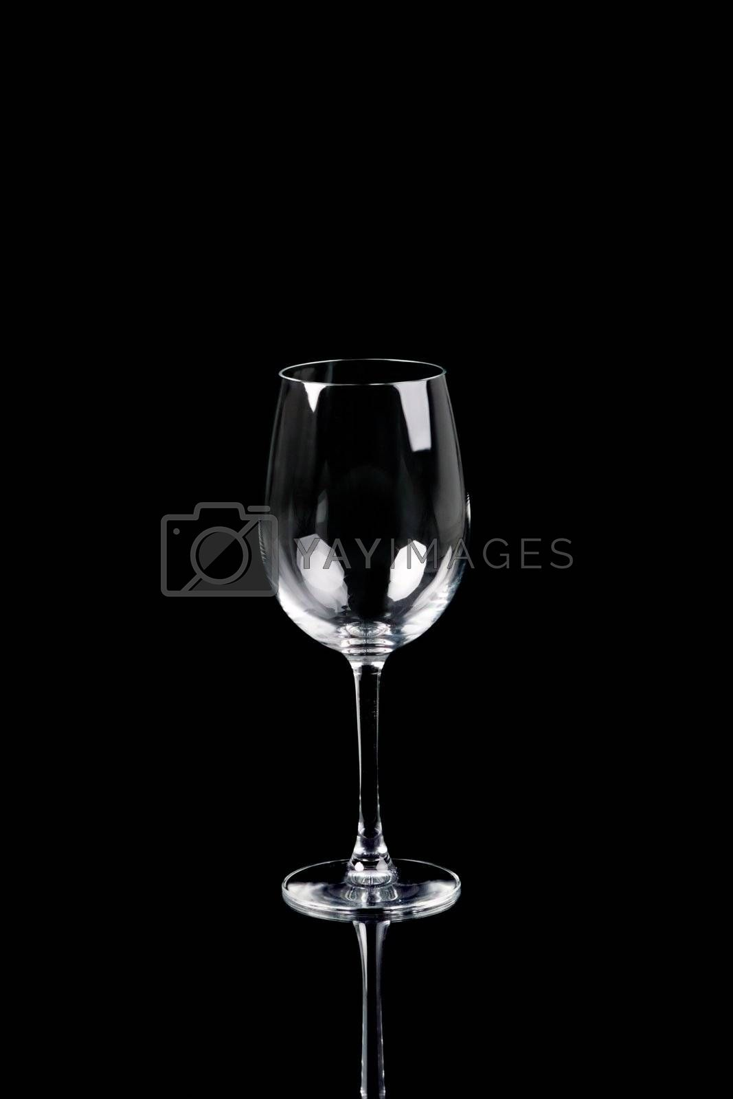 Empty wine glass on black background with reflection