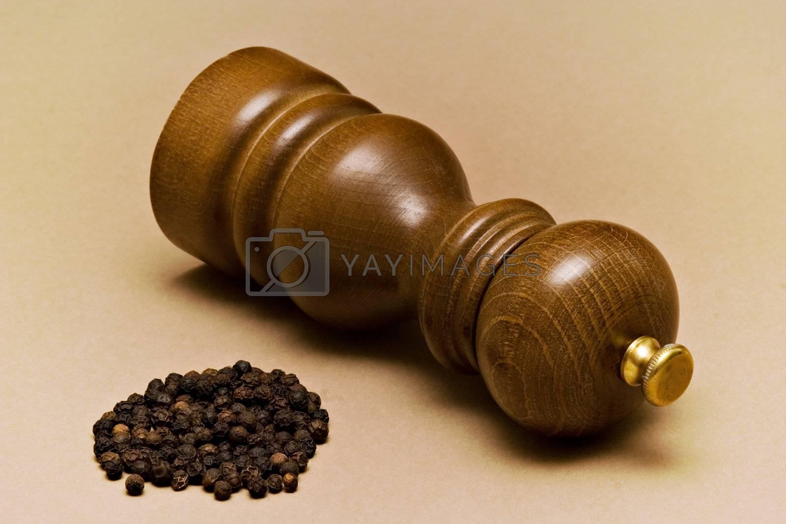 Pepper-mill and black pepper grains