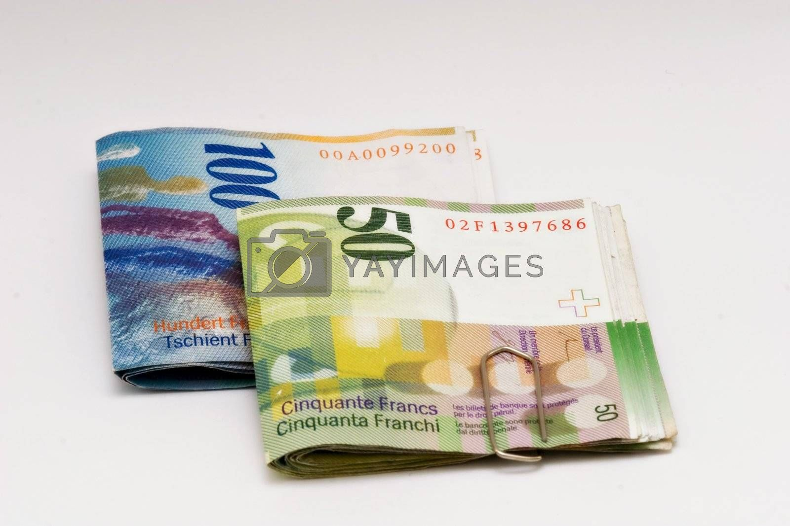 100 and 50 franc swiss bills isolated on white background
