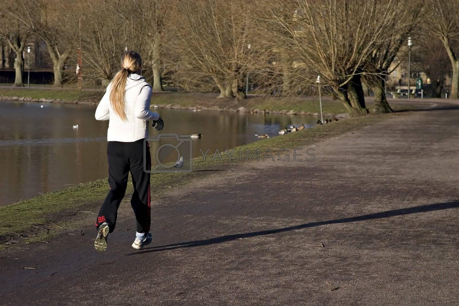 Girl running on park.
