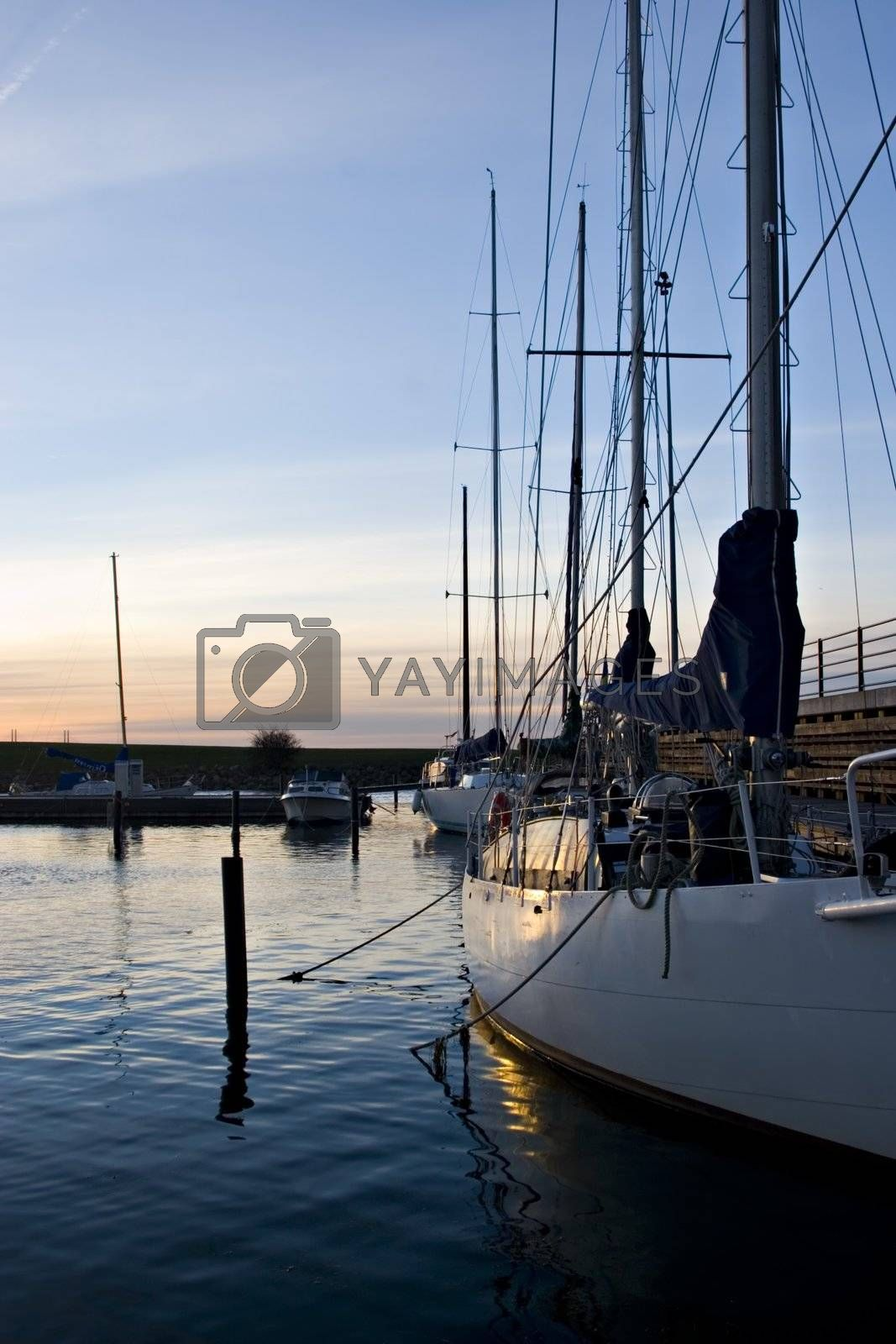 Yacht anchored on a marina in Malm�, Sweden at late afternoon light.
