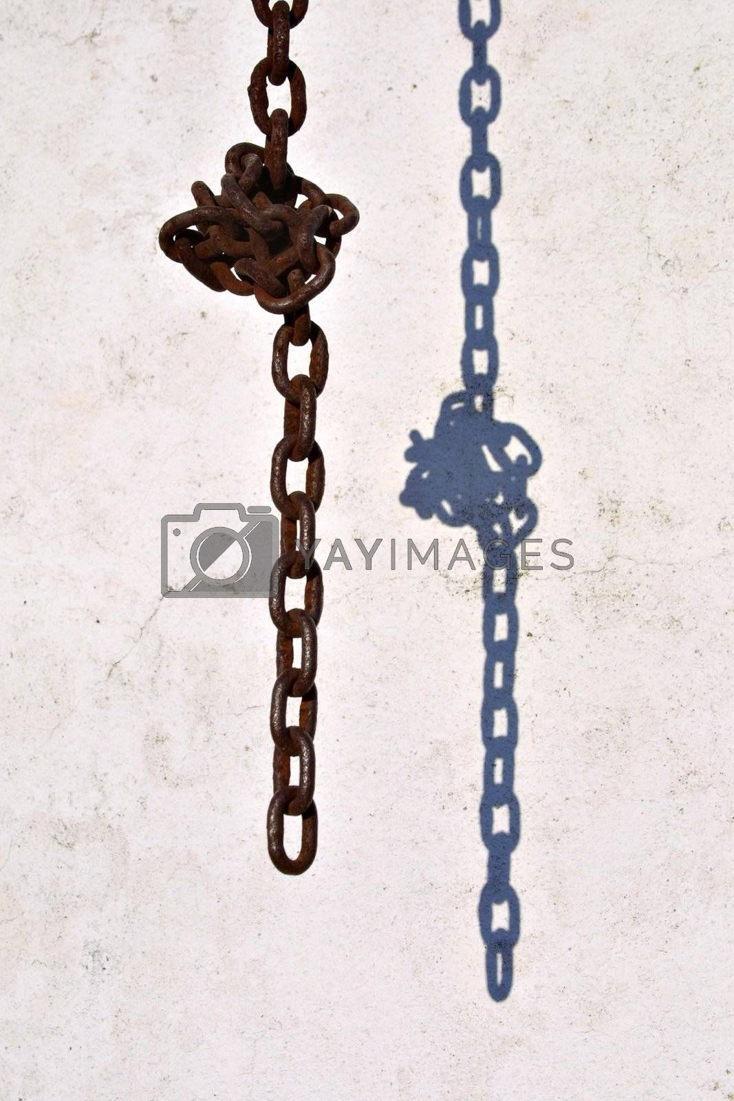 chain knot with shadow in wall