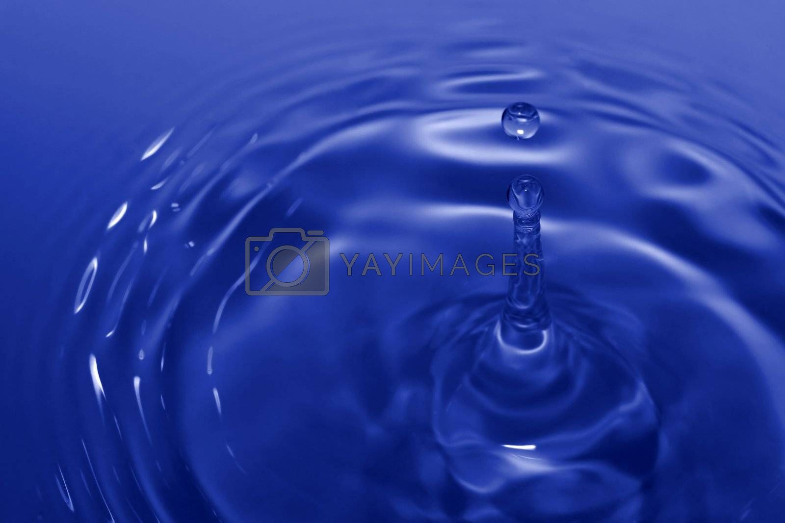 Blue drop and ripples