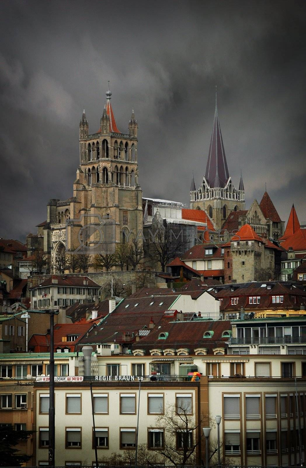 Portrait image of Lausanne showing steeples with a dramatic sky.